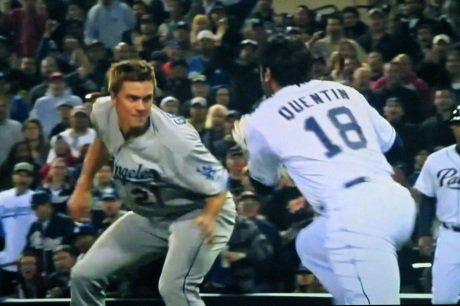 Dodger pitcher Zach Greinke stands his ground against charging Padre Carlos Quentin.