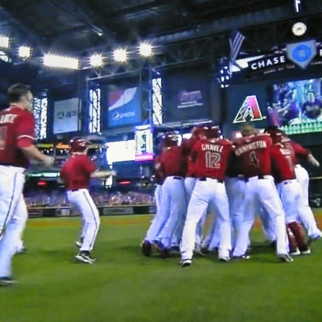 The Arizona Diamondbacks rush Paul Goldschmidt after his game-winning single.