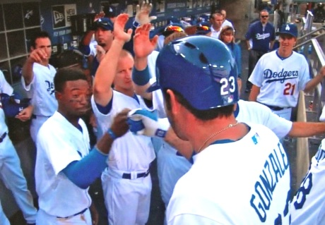 Shortstop Dee Gordon greets first baseman Adrian Gonzalez with a special ritual all their own after A-Gone's towering home run.
