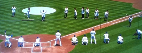 Moms throw the first pitch to their Dodger sons before a 5-3 victory over the Marlins.