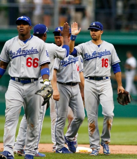 Yasiel Puig, left, and Andre Ethier, right, high-five teammates after a very solid win in Pittsburgh.
