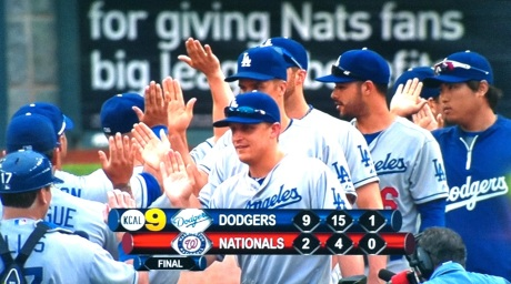 The Dodgers congratulate each other after sweeping the Nationals on Sunday.