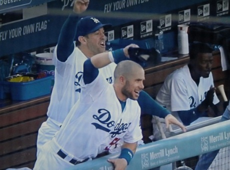 Nick Punto and Skip Schumaker cheer as Clayton Kershaw singles in two runs in the second inning.
