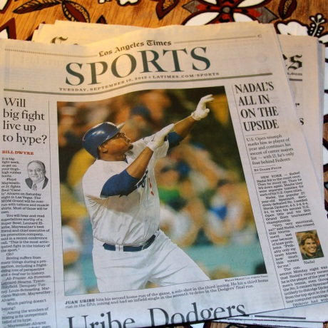 Nice photo in The Times by Wally Skalij shows Juan Uribe hitting one of three homers against Arizona.