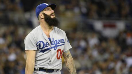 Dodgers relief pitcher Brian Wilson watches a 1-0 lead soar away.