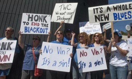 "That's me with the ""Honk to End the Blackout"" sign. / Photo by Miguel Vasconcellos, L.A. Register"