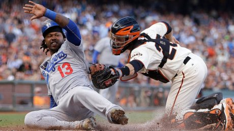 Hanley Ramirez barely beats tag by Buster Posey in 4-3 win for the Blue Crew.