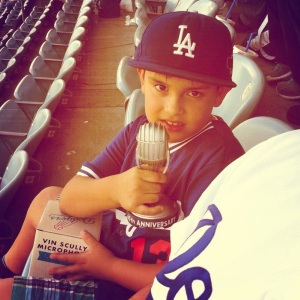 Young fan with his Vin Scully Anniversary Microphone.